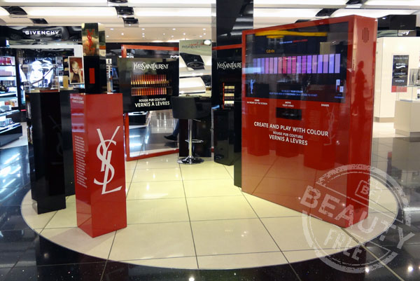 YSL Rouge Pur Couture Glossy Stain promotional display at Heathrow T5
